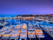 An evening photograph overlooking the Port Hercule, Principality of Monaco. The image was taken during the Formula 1 Grand Prix. Another of Crevisio's most famous photographs.